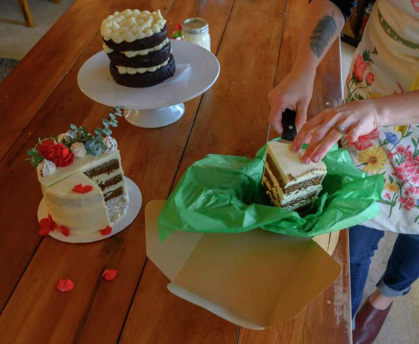 Libby Bellicosa's with her cake products for a photo shoot Tuesday Dec. 4, 2018 in Schenectady, N.Y. (Skip Dickstein/Times Union)
