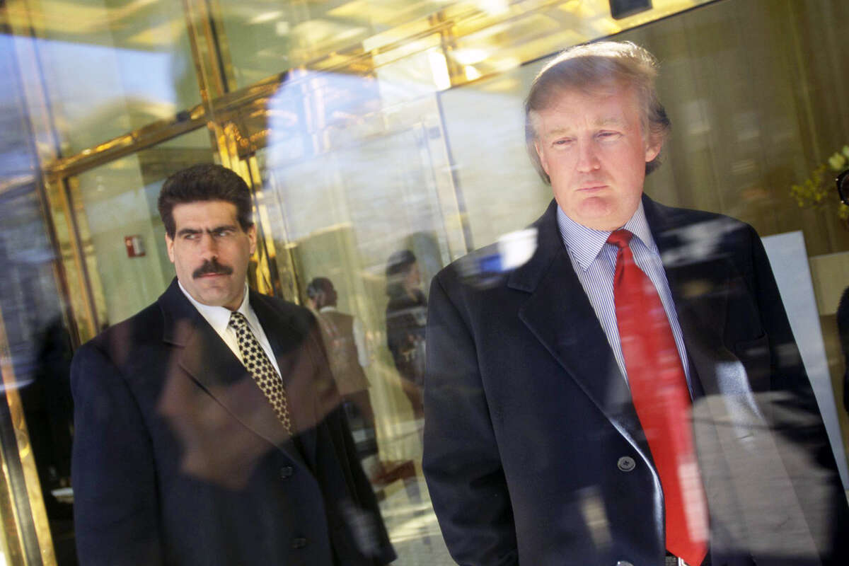 Donald Trump, with a security guard, Matthew Calamari, at the opening of the Trump International Hotel and Tower, formerly the Gulf & Western Building, in Manhattan's Columbus Circle in 1997. (Photo by James Leynse/Corbis via Getty Images)