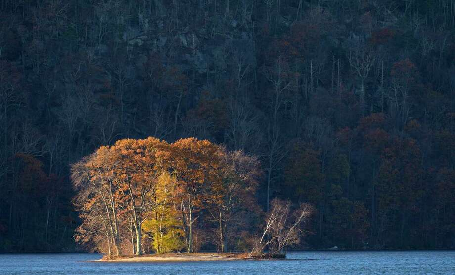 The last remaining leaves hanging onto the trees of City Island glow in the late afternoon light on Candlewood Lake, Danbury, Conn, on Friday, November 17, 2017. Photo: H John Voorhees III / Hearst Connecticut Media / The News-Times
