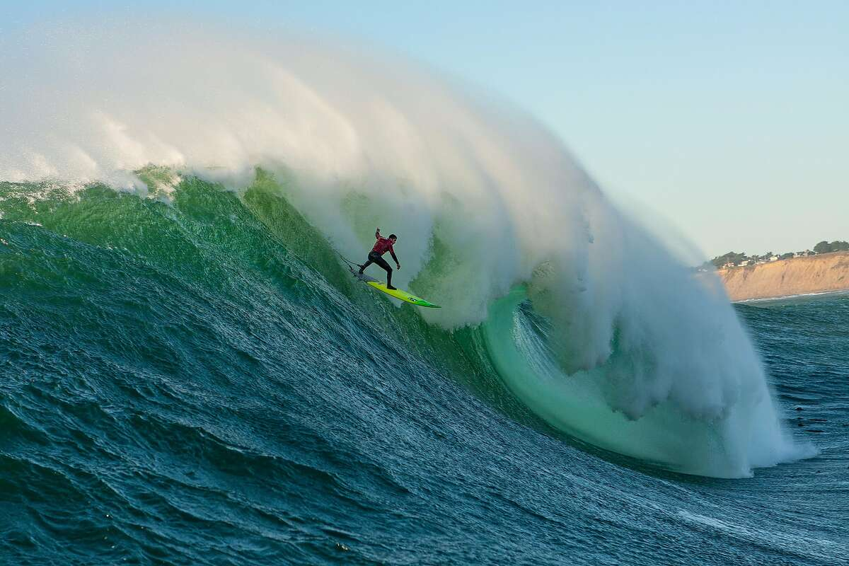 Surfer Luca Padua drops into a late-afternoon wave at Mavericks on Dec. 6, 2018.