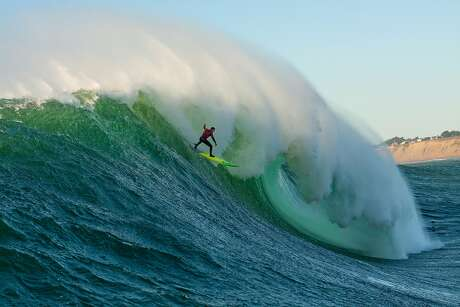 Surfer Luca Padua drops into a late-afternoon wave at Mavericks on Dec. 6, 2018. Photo: Frank Quirarte / 2018