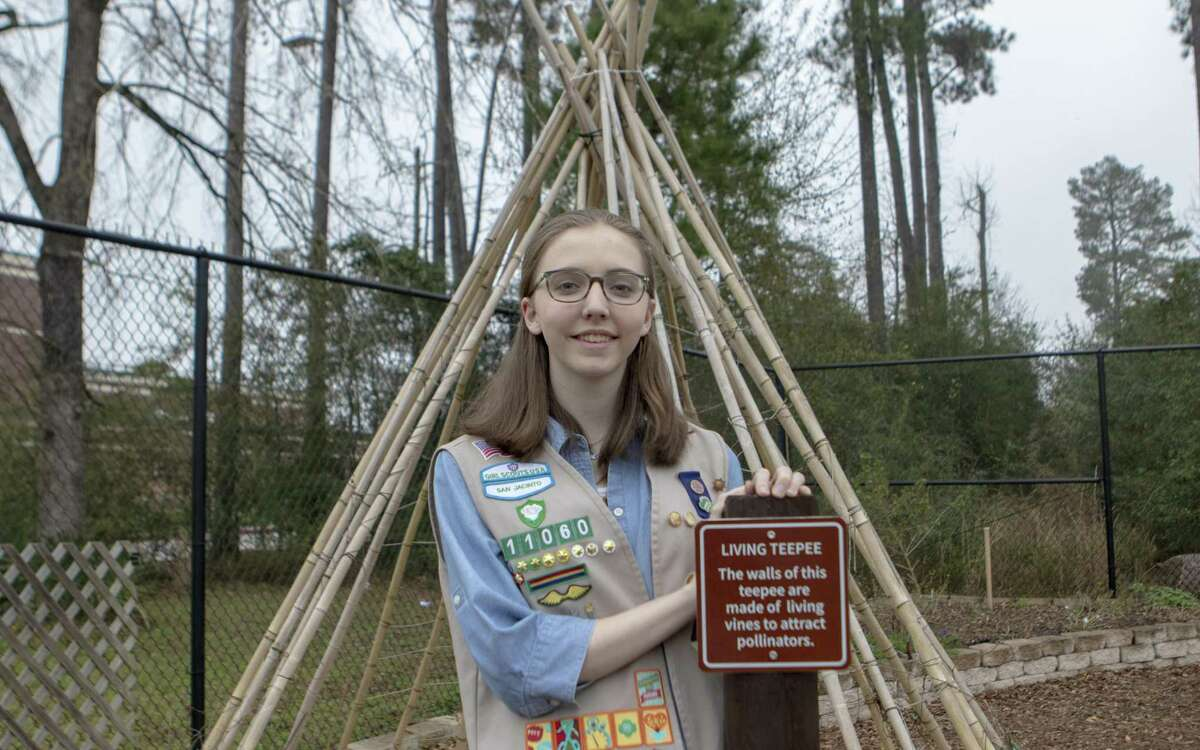 Scout Ellen Crawford stands in front of her gold award project, a living teepee, Tuesday, Feb. 26, 2019 at the Wendtwoods Community Vegetable Garden in The Woodlands.