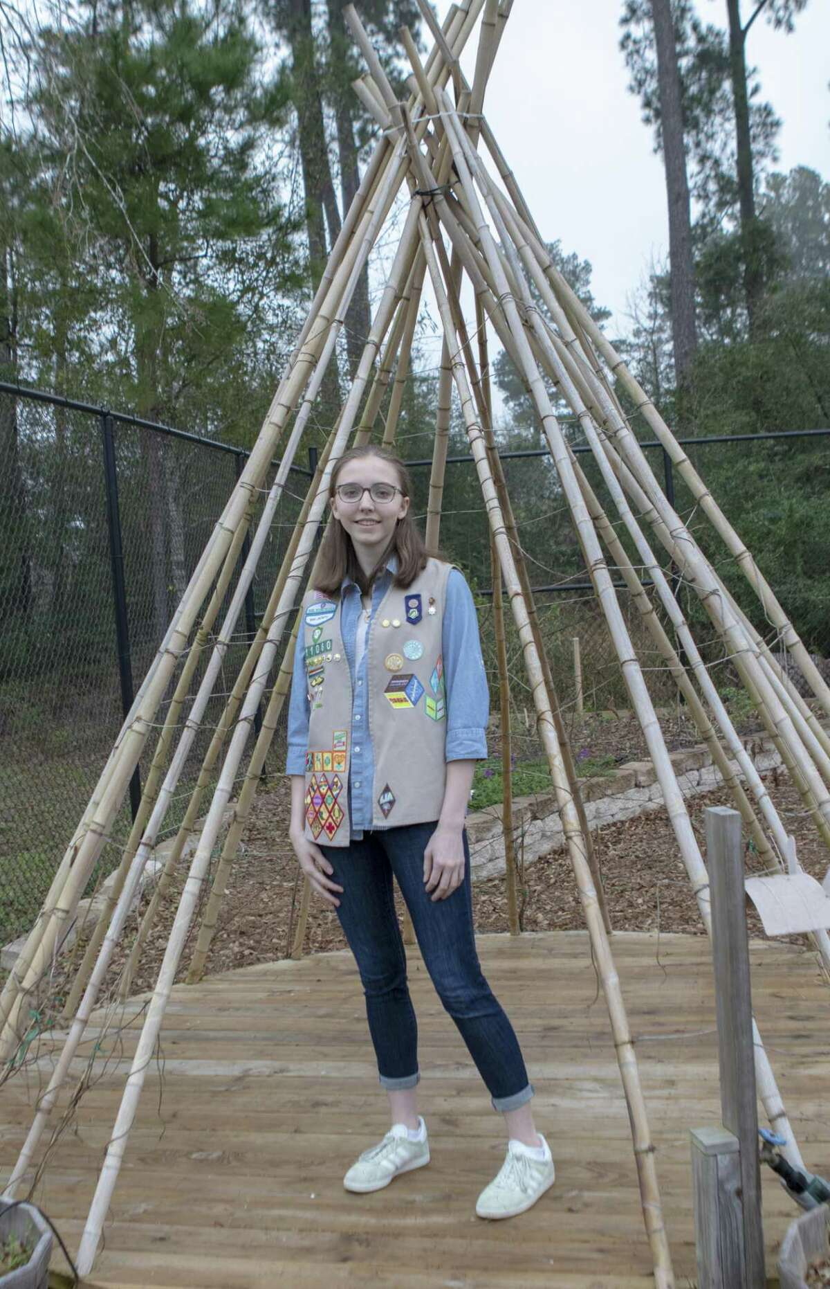 Scout Ellen Crawford stands inside the living teepee she planned and made Tuesday, Feb. 26, 2019 at the Wendtwoods Community Vegetable Garden in The Woodlands.