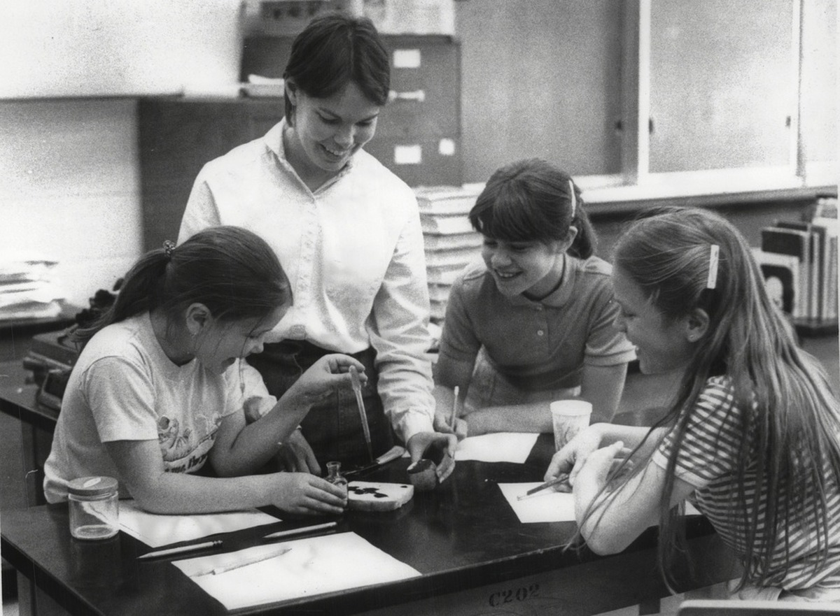 Niskayuna High School, New York - Girl Scout Troop 197. Jill Bandura, 10, teacher Candy Bandura, Adrienne Bertonneau, 11, and Sarah Fisher, 10, doing experiments with bread and potatoes and also made rock candy. June 08, 1983 (Paul D. Kniskern Sr./Times Union Archive)