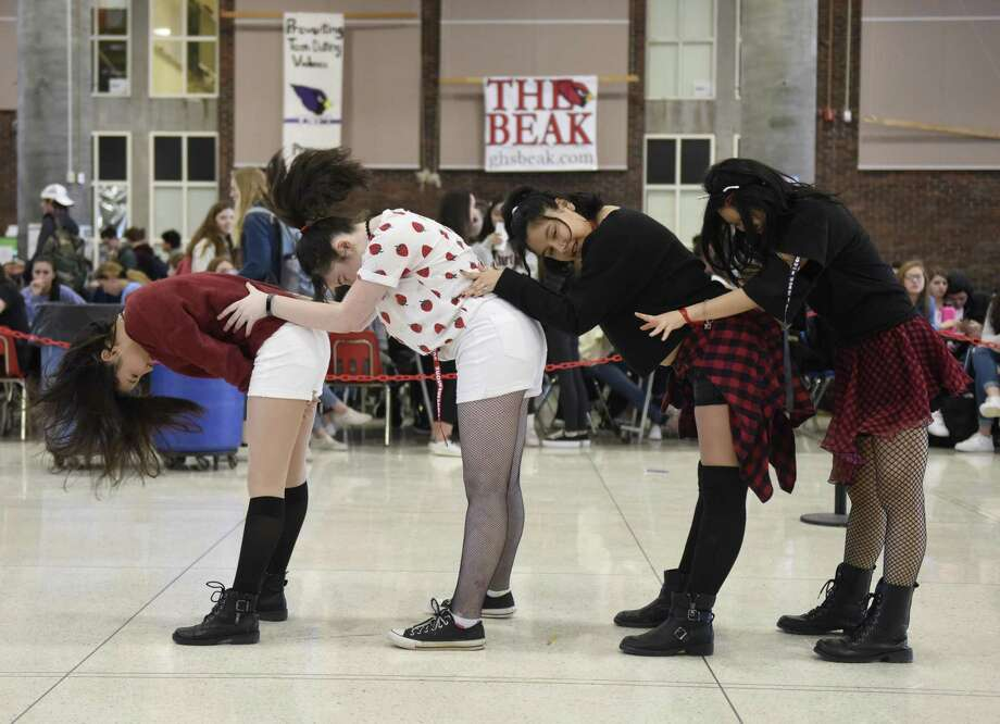 Above, Greenwich High School freshmen, from left, Esther Sha, Alicia Tang, Sophia Huaman, and Phebe Fabacher perform a K-pop dance routine as Carbon Dioxide Crush for a Diversity Awareness Week event in the school's student center Thursday. The dance troupe, formed by members of Korean Club, performed a dance routine mashup of nine K-pop songs as students gathered around to watch and cheer them on. Korean pop, familiarly known as K-pop, is a musical style that originated in South Korea but has recently gained popularity in the United States. Photo: Tyler Sizemore / Hearst Connecticut Media / Greenwich Time