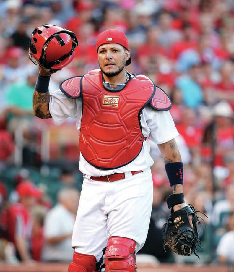 The Cardinals say Yadier Molina's first game behind the play in spring training will most likely be March 14. Photo: AP Photo