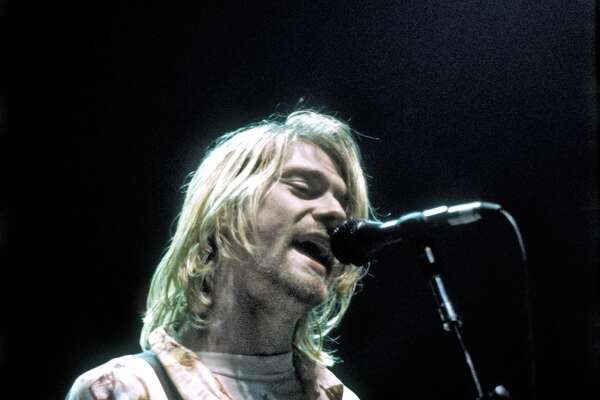 Rock musician Kurt Cobain of Nirvana plays his last US concert at the Seattle Arena on January 7, 1994 in Seattle, Washington. (Photo by Michael Ochs Archives/Getty Images)