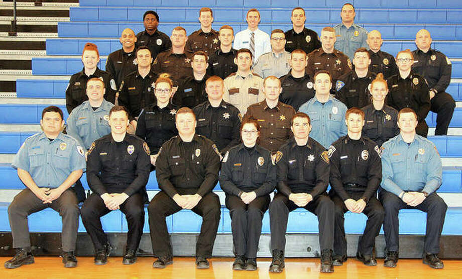 Graduates include, from left, front row: Officer Bruce K. Agbayani, Mounds Police Department; Officer Alex G. Bowman, Rock Island Police Department; Officer Taylor W. Brockman, Alton Police Department; Officer Casey M. Brown, Belleville Police Department; Officer Aric E. Cremer, Macomb Police Department; Officer Eric W. Emmons, Mount Carmel Police Department; Officer Geoffrey N. Fester, East Alton Police Department; (second row) Officer Nathan T. Hawkins, East Alton Police Department; Officer Rebecca S. Hudson, Collinsville Police Department–Winner, Academic Honors Award; Officer Steven R. Huffman, Macomb Police Department - Winner, Most Improved Overall in Physical Fitness Award; Deputy James W. Iglehart (of Mount Carmel), Richland County Sheriff's Department–Class President; Officer Cody M. Johnston, O'Fallon Police Department; Officer Taylor S. Kleiboeker, Mount Vernon Police Department; (third row) Officer Sarah E. Linder, Havana Police Department; Officer Brandon M. Lloyd, Roxana Police Department–Winner, Jeremy Chambers Top Gun Firearms Award; Officer Alexander A. Lorsbach, Lexington Police Department; Deputy Dylan T. Lyell (of Goreville), Johnson County Sheriff's Office; Officer Shane R. Mason (of FairviewHeights) Southern Illinois University Edwardsville Police Department–Winner, Defense Tactics Award; Officer Jordan L. McMillen, Greenfield Police Department; Officer Chasity R. Moses, Greenup Police Department; (fourth row) Officer Ian M. Parnell, Roxana Police Department; Deputy Tyler D. Reagan (of Moline), Rock Island County Sheriff's Office; Officer Marcus D. Root, Mount Carmel Police Department; Officer Jacob W. Sanders, Cobden Police Department; Deputy Jason B. Sandidge (of Godfrey) Madison County Sheriff's Office; Officer Jeremiah L.... Photo: Photo Courtesy Of Dena Roland-Woods, SWIC
