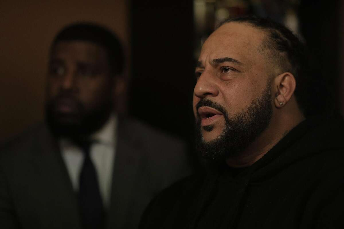 David Harrison, cousin of Willie McCoy, speaks to the press at the home of Kori McCoy, right, in Hercules, Calif., on Thursday, February 14, 2019. The family of Willie McCoy, who was shot and killed by Vallejo Police officers as he woke up from sleeping in his car at a Taco Bell restaurant, gathered for press conference to address their issues with how their loved one was killed.