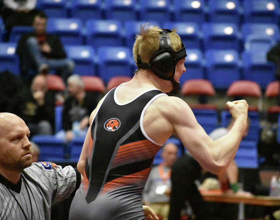 Edwardsville's Noah Surtin celebrates a victory in the Class 3A dual team state tournament on Feb. 23 at Grossinger Motors Arena in Bloomington. Photo: Matt Kamp/Intelligencer