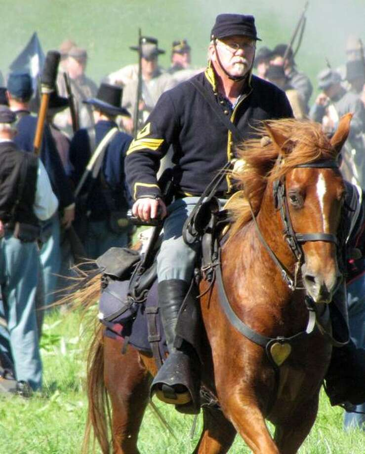 Paul Shetley participates in a previous reenactment of the Battle of Gettysburg as a soldier in the Illinois Ninth Volunteer Infantry during the Civil War. Photo: Photo Via Cindy Reinhardt