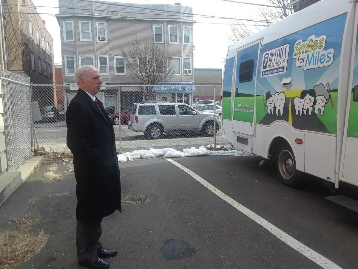 Ludwig Spinelli, CEO of Optimus Health Care in Bridgeport, stands with the new Optimus Health Care Smiles for Miles Mobile Dental Center, which will provide dental care at spots throughout the region. Optimus received $300,000 in federal grant money for oral health care.