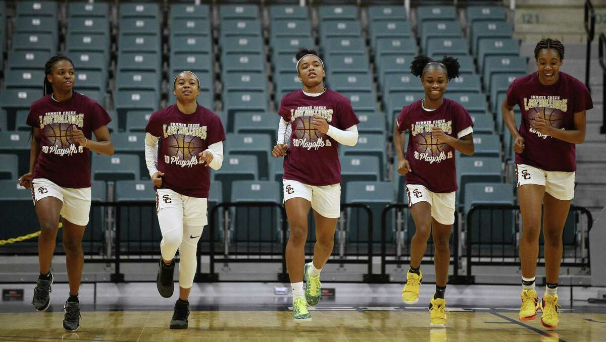 Summer Creek players warm up before a 6A regional championship basketball game against Westside, Saturday, Feb. 23, 2019, in Katy, TX.