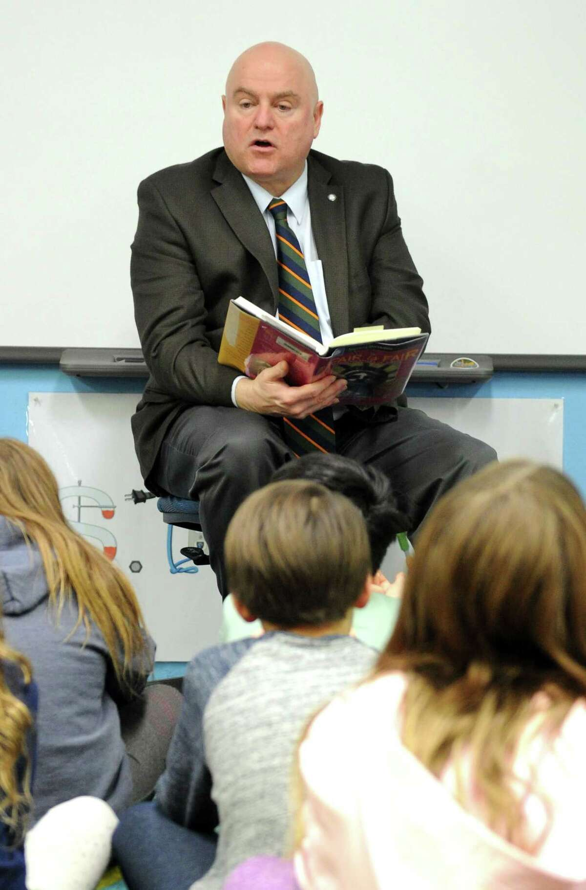 """Stamford Judge John Blawie reads """"The Stolen Smells"""" from the book Fair is Fair; World Folktales of Justice, a collection of short stories curated by Sharon Creeden to third-graders at Parkway School in Greenwich, Conn. on Feb. 28, 2019. Blawie was participating in Read Across America, a program that promotes literacy and his readings tied in with the students current social studies curriculum."""