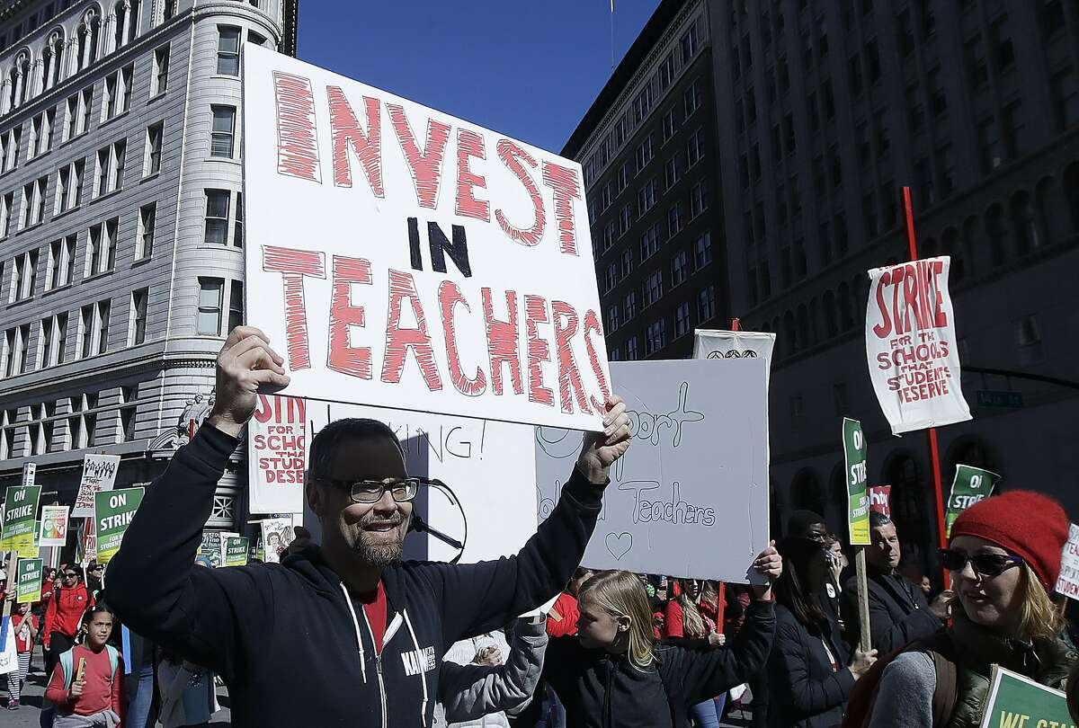 Teachers, students and supporters march in Oakland, Calif., Thursday, Feb. 21, 2019. Teachers in Oakland, California, went on strike Thursday in the country's latest walkout by educators over classroom conditions and pay. (AP Photo/Jeff Chiu)