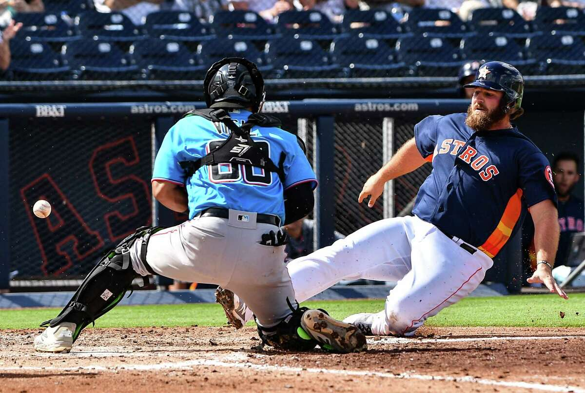 WEST PALM BEACH, FL - FEBRUARY 28: Tyler White #13 of the Houston Astros scores in the fourth inning against the Miami Marlins at The Ballpark of the Palm Beaches on February 28, 2019 in West Palm Beach, Florida.