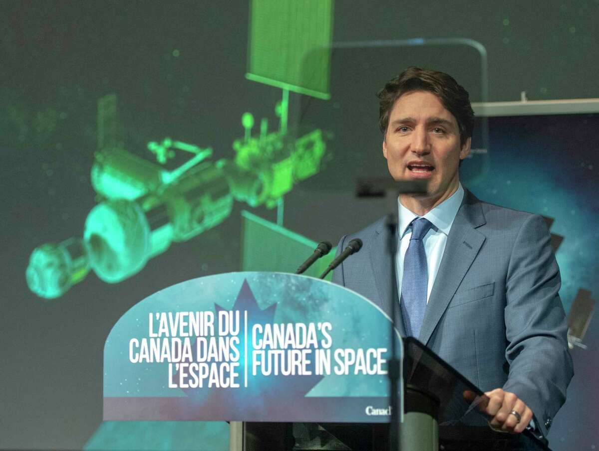 Canada's Prime Minister Justin Trudeau announces during a news conference, Thursday, Feb. 28, 2019, at the Canadian Space Agency headquarters in St. Hubert, Quebec, that Canada will take part in an international lunar space station project. (Ryan Remiorz/The Canadian Press via AP)