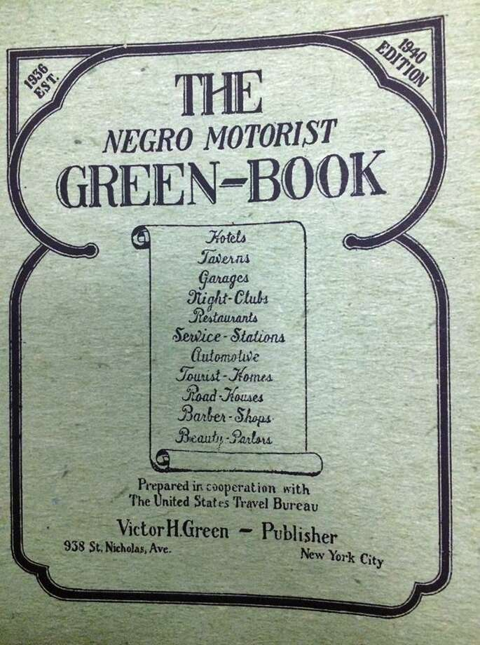 """The Negro Motorist Green-Book"" was a guide used by people of color to help them find establishments including hotels, restaurants, service stations and more that would accept them in the segregated Jim Crow South. A 1940s copy is available at the Fairfield Museum. Photo: Contributed /"