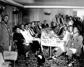 Ella Fitzgerald (seated to the left) and other San Francisco luminaries in the Booker T. Washington Hotel in the Fillmore during the 1950s.