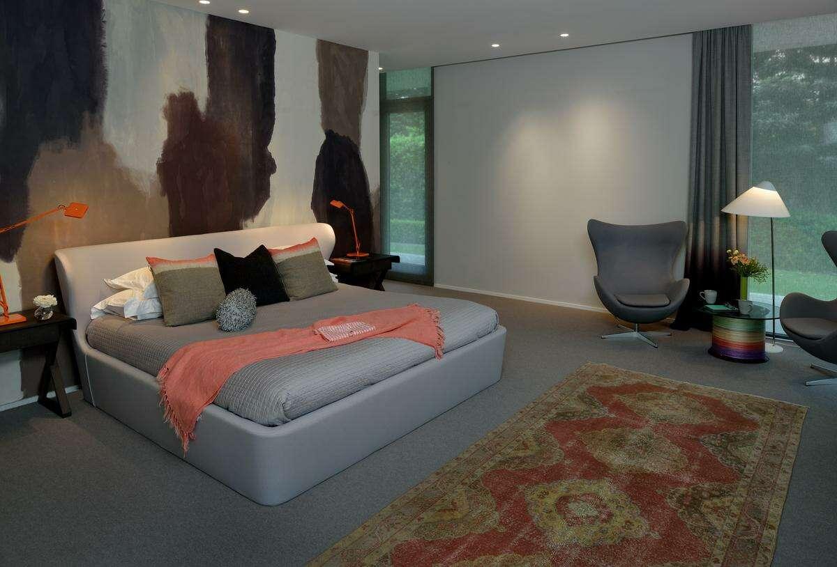 Hand-painted, custom designed wallpaper makes a bold statement in this master bedroom by Meedi Hidalgo ofMeedi Hidalgo Design.