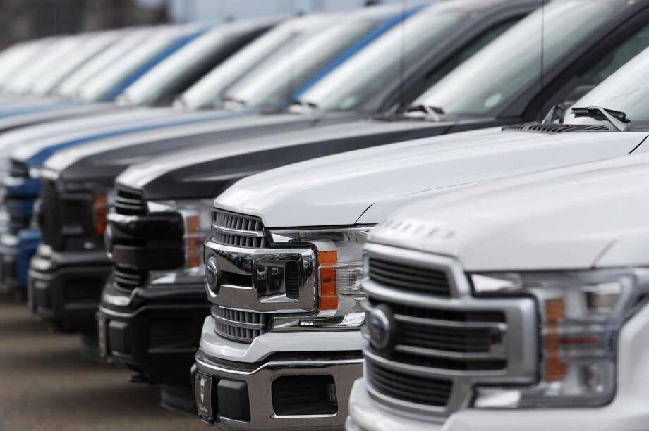 FILE--In this Sunday, Feb. 17, 2019, file photograph, a long row of unsold 2019 F150 pickup trucks sits at a Ford dealership in Broomfield, Colo. (AP Photo/David Zalubowski) Photo: David Zalubowski, STF / Associated Press / Copyright 2019 The Associated Press. All rights reserved.