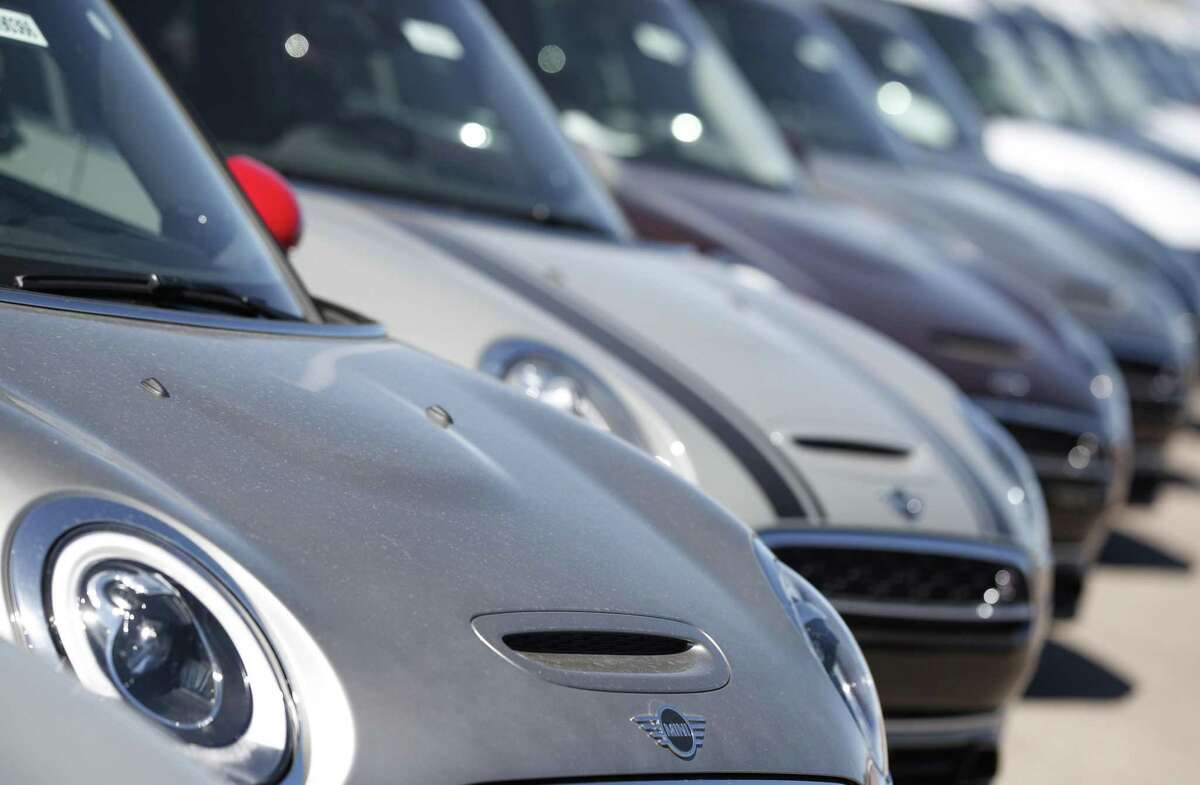 In this Sept. 14, 2018, photo, a long line of 2019 Clubman models sits at a Mini Cooper dealership in Highlands Ranch, Colo. (AP Photo/David Zalubowski)