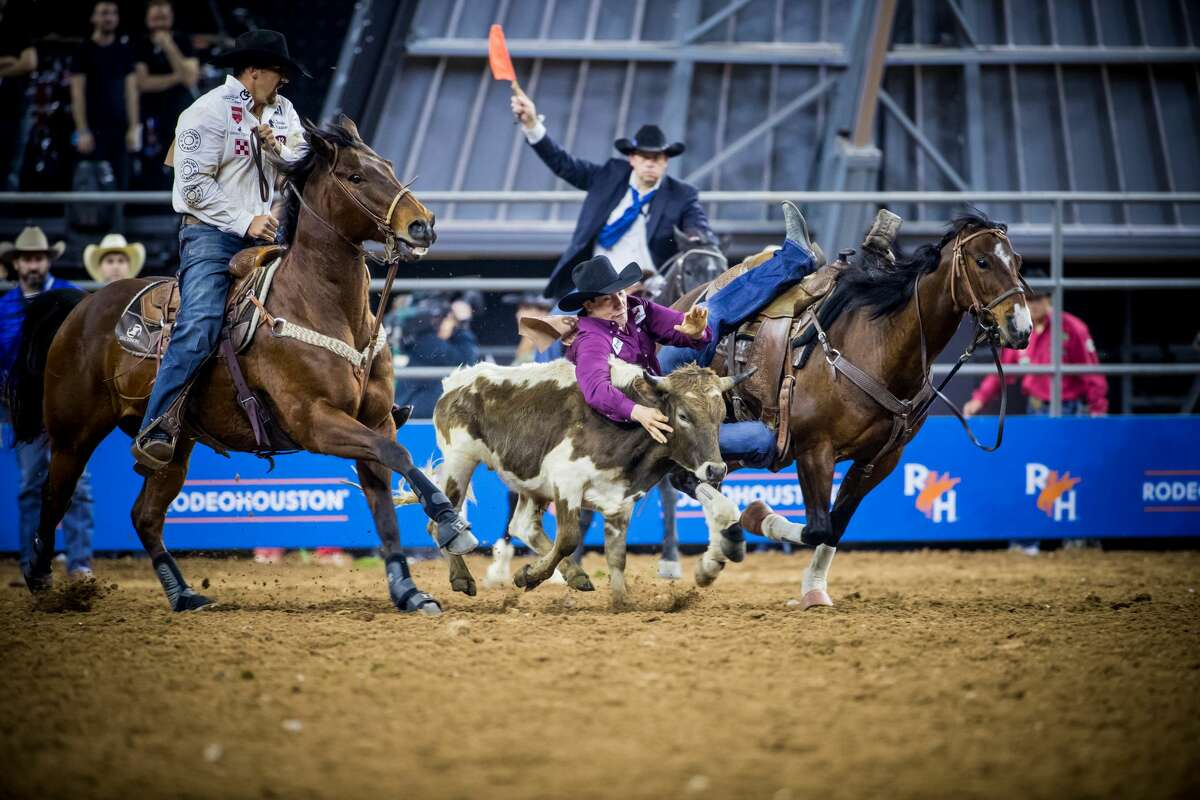 Thousands of people come to Houston for the annual Houston Livestock Show and Rodeo and events such as steer wrestling.