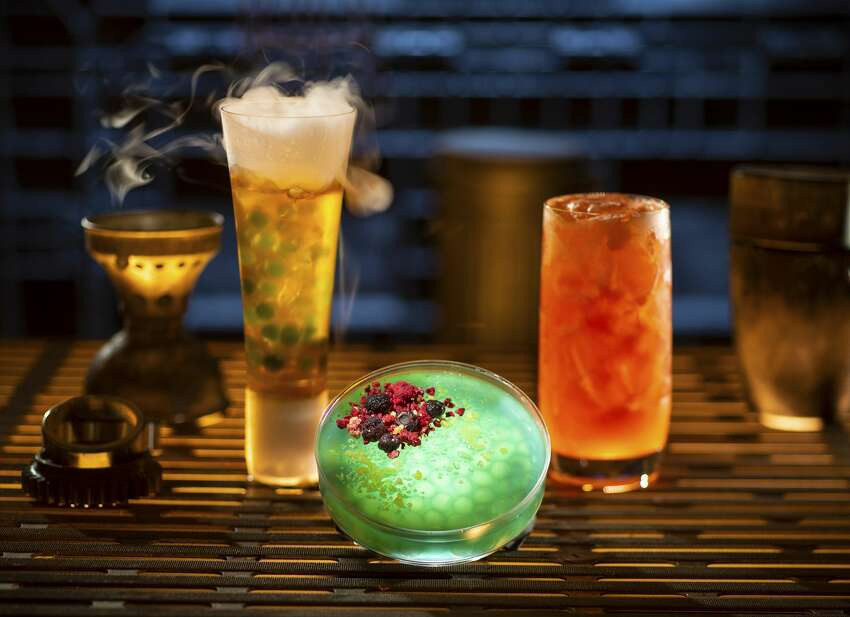 Innovative and creative drinks from around the galaxy will be available at Star Wars: Galaxy's Edge when it opens in summer 2019 at Disneyland Park in Anaheim, Calif. Left to right, non-alcoholic drinks: Carbon Freeze, Oga's Obsession provision and Cliff Dweller can be found at Oga's Cantina inside Star Wars: Galaxy's Edge.