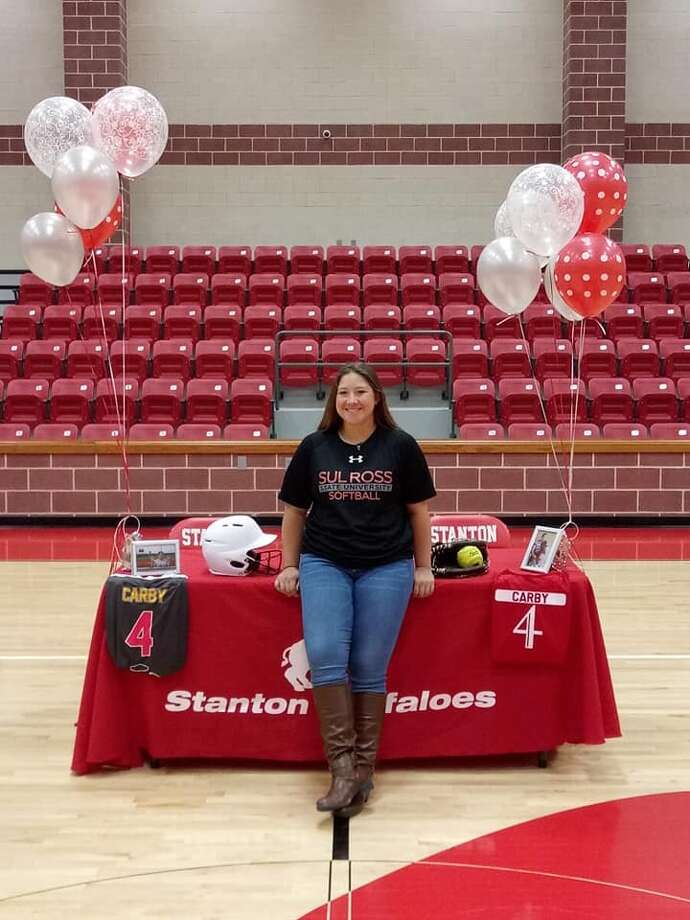 Stanton's Victoria Carby poses after signing with Sul Ross State to play softball on Wednesday. Photo: Courtesy Photo