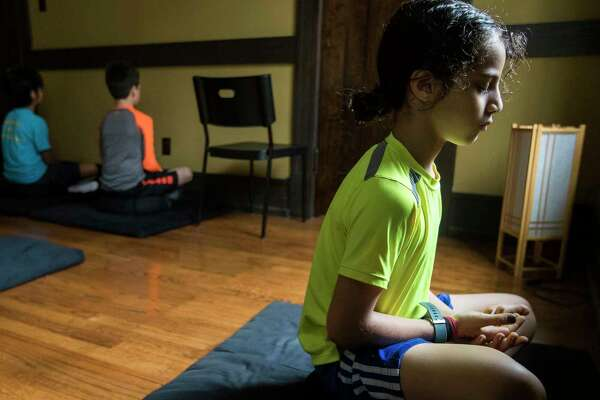 Mindfulness for third-graders? Meditation, yoga help kids