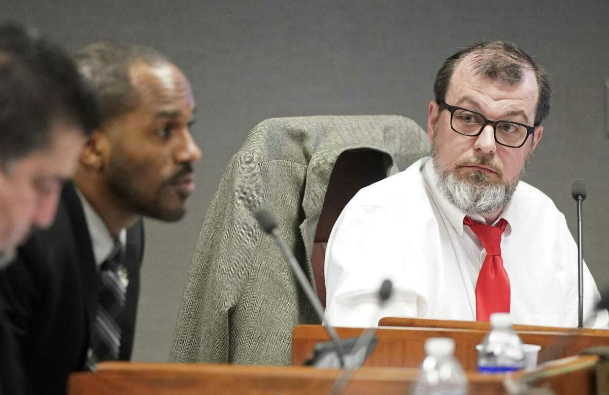 Eric Dick, right, listens as fellow board member Danny Norris, left, speaks during the Harris County Dept. of Education board meeting Wednesday, Feb. 27, 2019, in Houston.