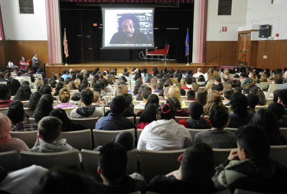 In celebration of Black History Month, Dolan Middle School hosts an all-school Skype visit with award-winning author Jason Reynolds on Wednesday. Reynolds was named a National Book Award Finalist for Young People's Literature for his book, Ghost. Photo: Matthew Brown / Hearst Connecticut Media / Stamford Advocate