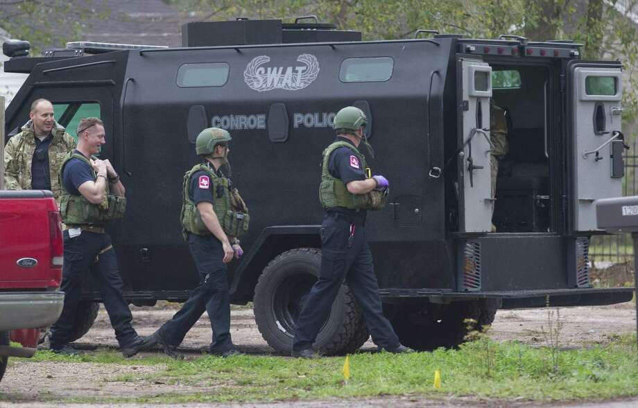 Medical personnel walk past a Conroe Police SWAT vehicle at a scene near South Seventh Street and Silverdale Drive, Thursday, Feb. 28, 2019, in Conroe. Photo: Jason Fochtman, Houston Chronicle / Staff Photographer / © 2019 Houston Chronicle