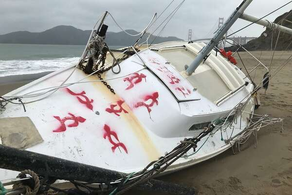 Washed-up sailboat at Baker Beach: High and dry and covered