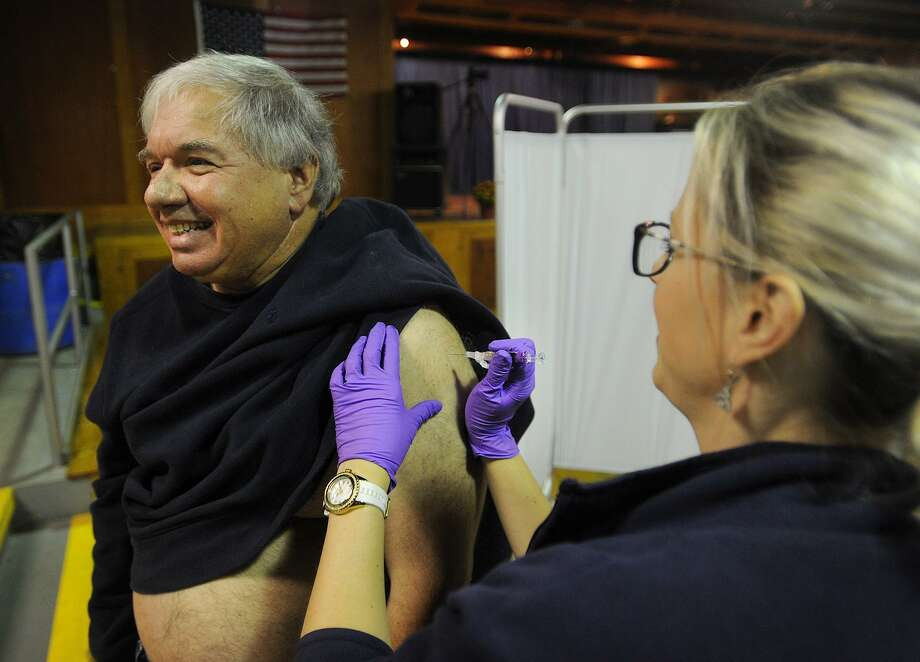 David Arruzza, of Ansonia, gets his annual flu shot from Naugatuck Valley Health District nurse Kristin Charest, RN, at Senator George Logan's 17th Senate District Annual Senior Health and Wellness Fair at Warsaw Park in Ansonia, Conn. on Wednesday, October 17, 2018. Photo: Brian A. Pounds / Hearst Connecticut Media / Connecticut Post