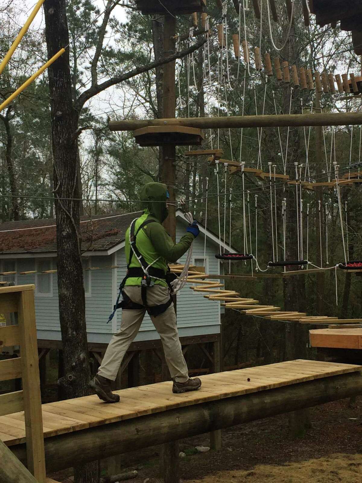 In this April 2019 archive photograph, an employee of Texas TreeVentures practices safety maneuvers prior to the official opening. Six months after opening, nearly 5,500 paid customers have gone through the complex, challenging course located in the scene tree-lined landscape of Rob Fleming Park in the south area of The Woodlands.