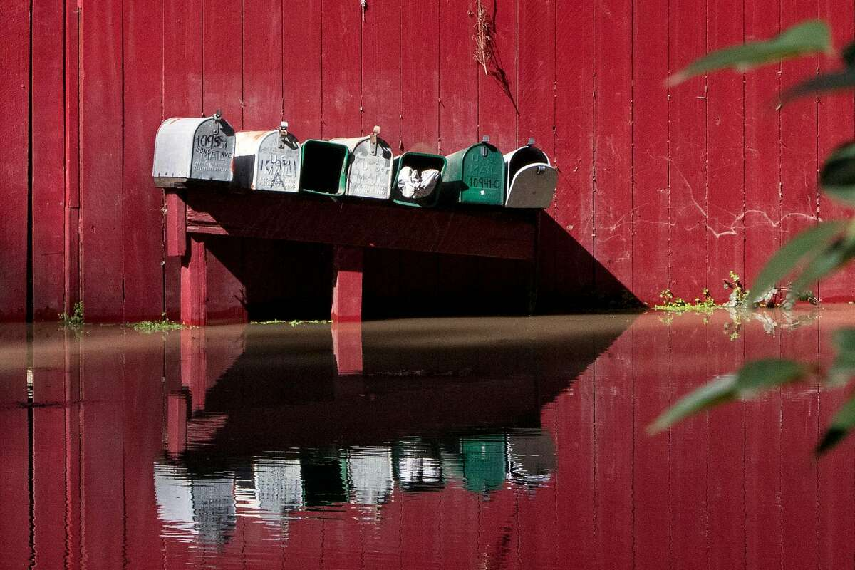 Mailboxes are seen partially submerged outside a home along the flooded Russian River in Forestville, Calif. Thursday, Feb. 28, 2019.