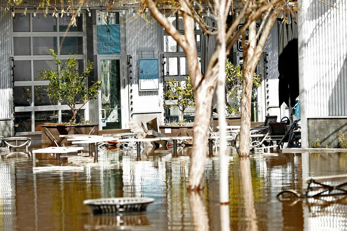 Flooding surrounds The Farmer's Wife cafe at The Barlow in Sebastopol, Calif., on Thursday, February 28, 2019.