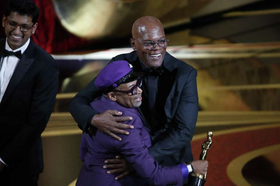 """BlacKkKlansman"" director Spike Lee celebrates with presenter Samuel L. Jackson after Lee won an Oscar for best adapted screenplay, in Los Angeles, Feb. 24. Despite what the president tweeted later, there was no racist attack on the president in Lee's acceptance speech. Photo: NOEL WEST /NYT / NYTNS"