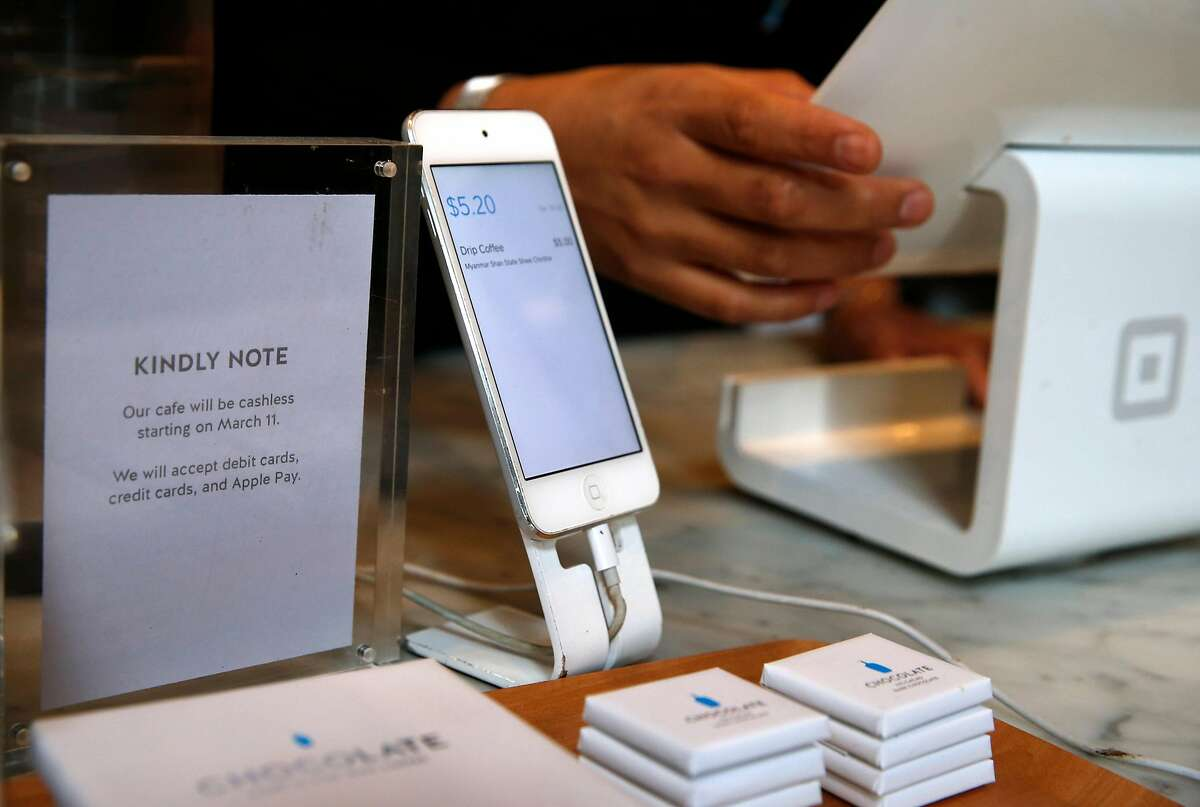 A note on the counter informs customers that cash will no longer accepted at Blue Bottle Coffee at Market and 10th streets in San Francisco, Calif. on Thursday, Feb. 28, 2019. The cafe inside the Twitter headquarters building is one of a handful of Blue Bottle stores that will go cashless for a trial period beginning March 11.