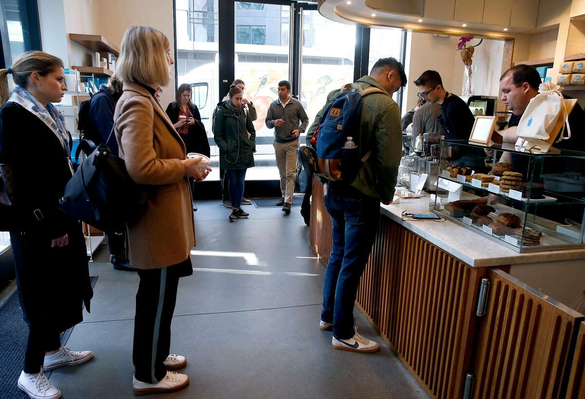 Customers wait in line at Blue Bottle Coffee at Market and 10th streets in San Francisco, Calif. on Thursday, Feb. 28, 2019. The cafe inside the Twitter headquarters building is one of a handful of Blue Bottle stores that will go cashless for a trial period beginning March 11.