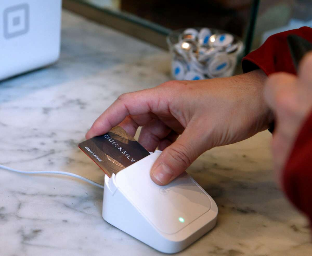 Josh Tabak pays for his beverage with a credit card at Blue Bottle Coffee at Market and 10th streets in San Francisco, Calif. on Thursday, Feb. 28, 2019. The cafe inside the Twitter headquarters building is one of a handful of Blue Bottle stores that will go cashless for a trial period beginning March 11.