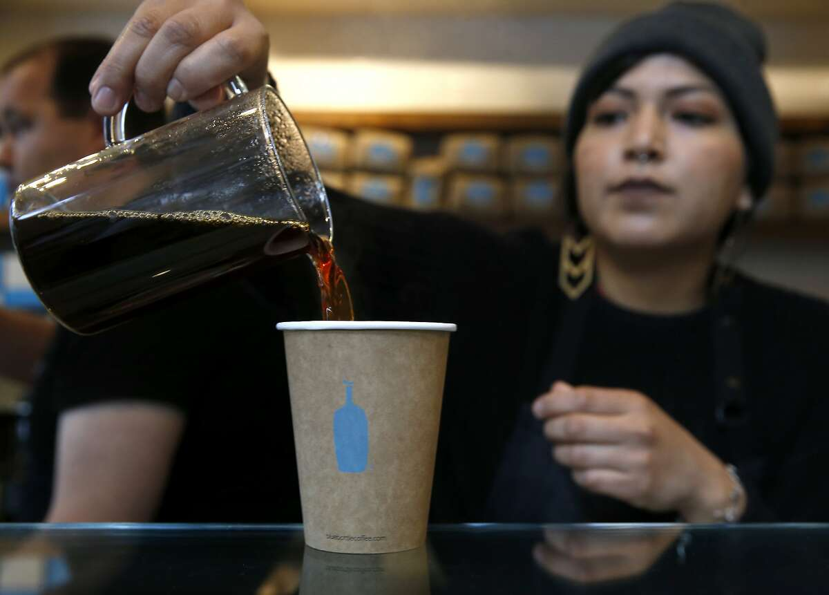 Barista Yana Powers pours drip coffee at Blue Bottle Coffee at Market and 10th streets in San Francisco, Calif. on Thursday, Feb. 28, 2019. The cafe inside the Twitter headquarters building is one of a handful of Blue Bottle stores that will go cashless for a trial period beginning March 11.