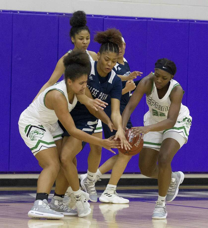 College Park forward Sandra Cannady (middle), shown here against Spring during the playoffs, was named District 15-6A Most Valuable Player. Photo: Jason Fochtman, Houston Chronicle / Staff Photographer / © 2019 Houston Chronicle