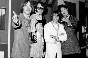 This July 6, 1967,  photo shows, from left, Peter Tork, Mike Nesmith, David Jones and Micky Dolenz of the musical group The Monkees at a news conference at the Warwick Hotel in New York.