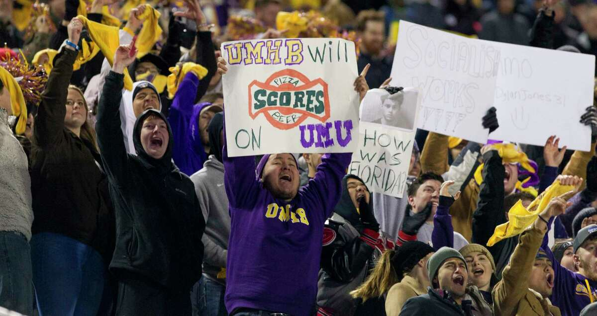 Mary Hardin-Baylor fans cheer during the second quarter of the Stagg Bowl NCAA DivisionIII college football championship at Woodforest Bank Stadium, Friday, Dec. 14, 2018, in Shenandoah.