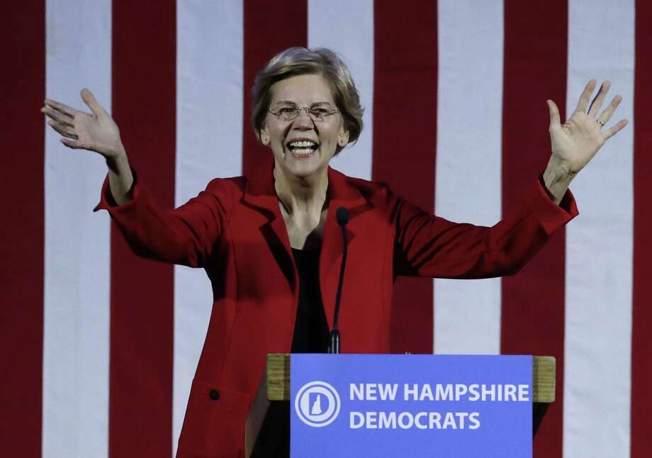 Democratic presidential candidate Sen. Elizabeth Warren, D-Mass., acknowledges applause at the New Hampshire Democratic Party's 60th Annual McIntyre-Shaheen 100 Club Dinner, Friday, Feb. 22, 2019, in Manchester, N.H. (AP Photo/Elise Amendola) Photo: Elise Amendola, STF / Associated Press / Copyright 2019 The Associated Press. All rights reserved