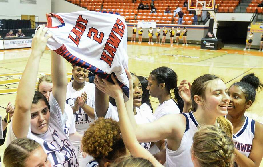 Hardin-Jefferson's Savannah Trahan lifts up Alix Neel's jersey after the regional final playoff game at Sam Houston State University on Saturday. Photo taken on Saturday, 02/23/19. Ryan Welch/The Enterprise Photo: Ryan Welch, The Enterprise / ©Ryan Welch