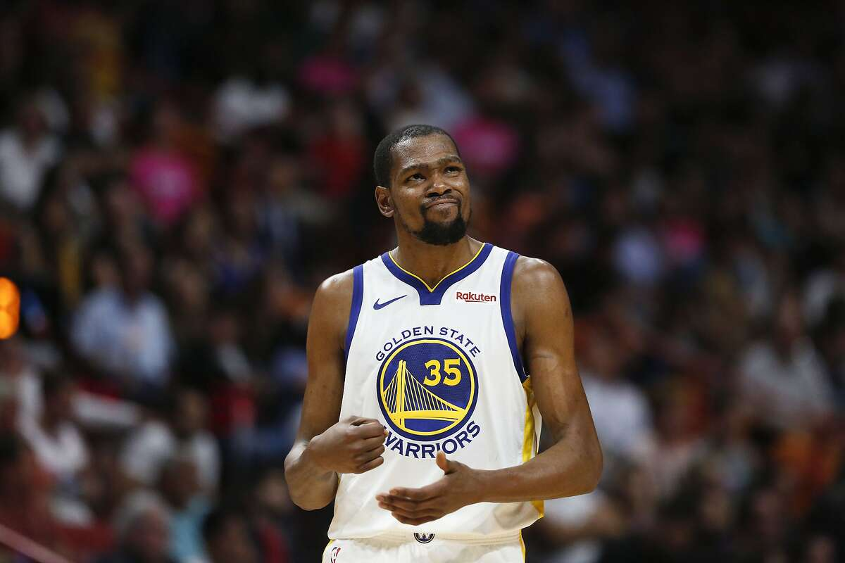 FILE - Golden State Warriors forward Kevin Durant (35) reacts after missing a shot during the second half of an NBA basketball game in this Wednesday, Feb. 27, 2019 file photo in Miami. The Warriors star finally revealed why he used burner social media accounts during the 2017-2018 NBA season.