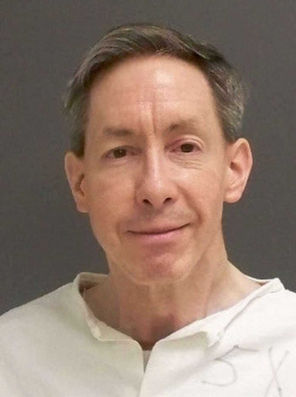 A Utah lawmaker argues that law, and the legacy of raids in the 1950s, has created a culture of fear that empowers notorious abusers like the polygamous leader Warren Jeffs, shown above. He is now serving a life prison sentence in Texas for sexually assaulting girls he considered plural wives.